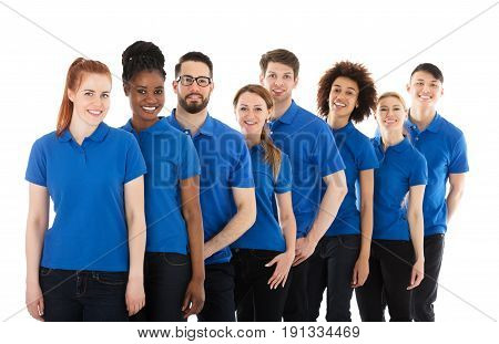 Group Of Young Janitors Standing In Row Against White Background