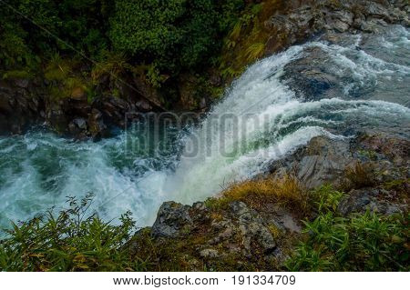 Water from volcano Mt Ruapehu forms Tawhai Falls in Tongariro National Park, New Zealand, lateral view.