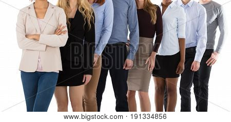 Smiling Multiracial College Students Standing In Row Against White Background