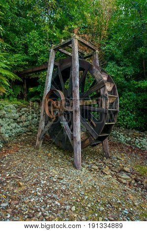 Beautiful wooden paddle wheel driven watermill inside the forest in south island, in New Zealand.