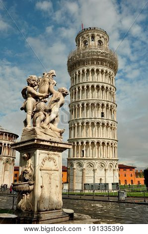 Pisa Italy,November 3rd 2010.Pisa's world famous attraction is the Leaning Tower.The tower,duomo and baptistery are in the Field of Miracles.Come to Pisa and enjoy the sites and take many photos.Pisa in Tuscany Italy a great travel destination.