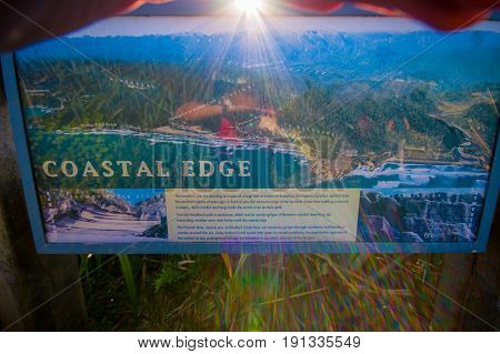 SOUTH ISLAND, NEW ZEALAND - MAY 19, 2017: An informative sign of the coastal edge in West Coast, South Island, New Zealand.