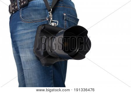 Male legs in jeans and belt holding gigital camera