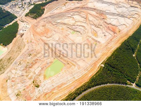 Aerial view to Kaznejov kaoline quarry. It is biggest quarry of its kind in Europe. Heavy industry from above. Industrial area in Czech Republic.