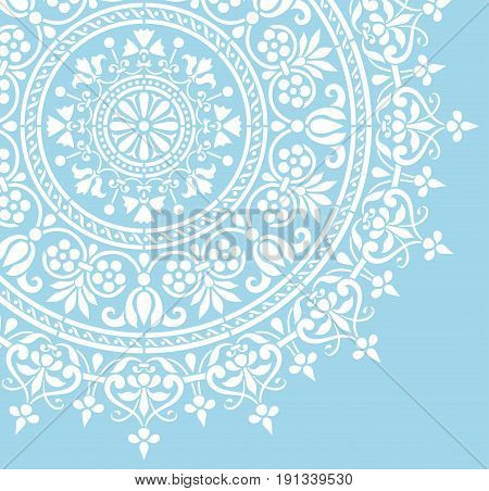 round Indian white floral pattern on a blue background