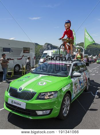 Pas de Peyrol France - July 62016: The Globe Trotter Skoda during the passing of the Publicity Caravan on the road to Pas de Pyerol (Puy Mary) in Cantalin the Central Massif during the stage 5 of Tour de France on July 6 2016. Skoda provides the official