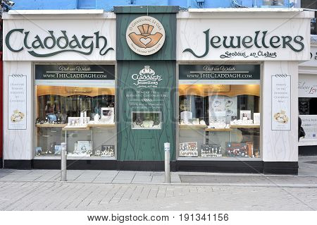 Shop Street, Galway, Ireland June 2017, Claddagh Jewellers Shop, Forehead Of The Jewellery Which Cra