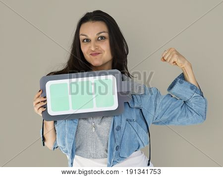 Young woman holding full battery on her hand