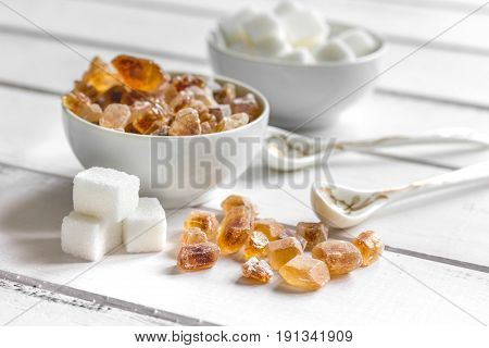 cooking sweets set with different sugar lumps on kitchen white table background close up