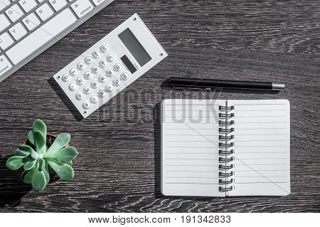 accountant or banker desk with calculator and keyboard on dark wooden background top view mockup