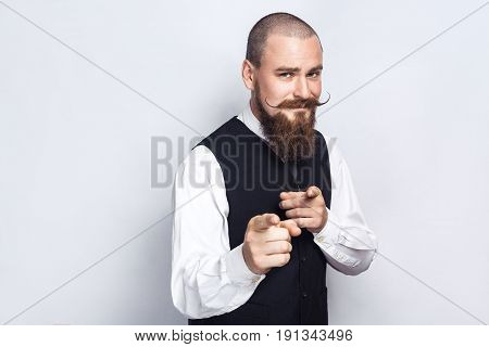 Hey you. Handsome businessman with beard and handlebar mustache looking at camera. studio shot on gray background.