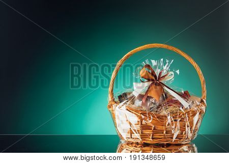 gift basket on emerald background