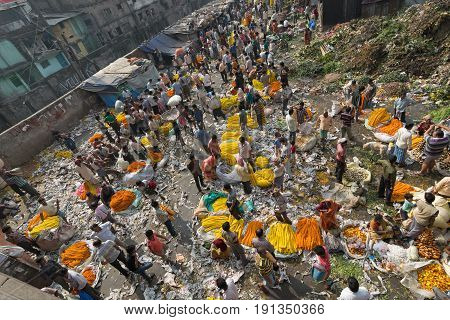 KOLKATA WEST BENGAL / INDIA - FEBRUARY 13TH 2016 : Top view of Busy crowded and colorful Mallik Ghat or Jagannath ghat flower market in Kolkata.. One of Biggest flower markets in Asia.