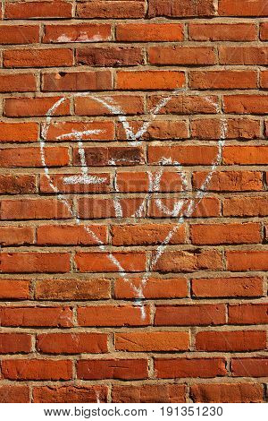 Vow written in heart on red brick wall