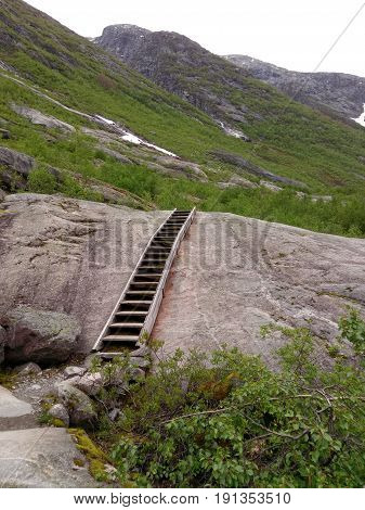 Norway mountain landscape with wooden stairs downhill