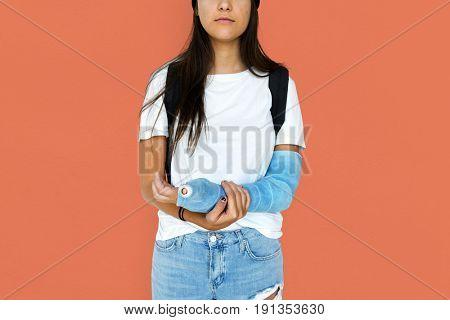 Young Adult Woman with Broken Arm Studio Portrait
