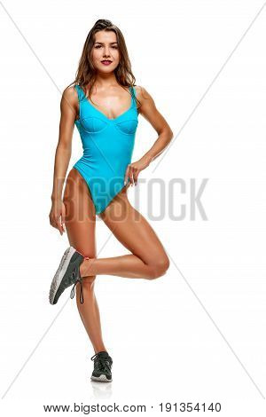 Young athletic woman in sportswear isolated on white background