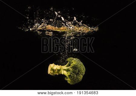 Photo of a vegetables and fruits dropped under water soft and select focus greenery tone 2017