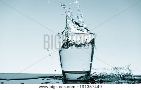 Water splash in glass. Drinking water concept
