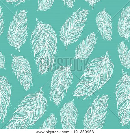 seamless pattern with white feathers on blue background