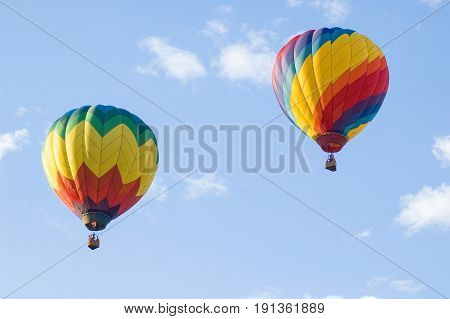 Two hot air balloons soaring in the air