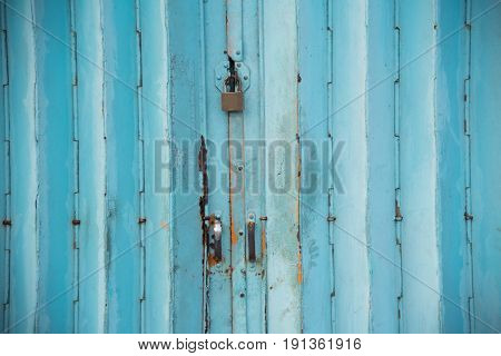 Mettalic Lock Without The Key On The Blue Vintage Door,residential Mettalic Folding Door With Blue L