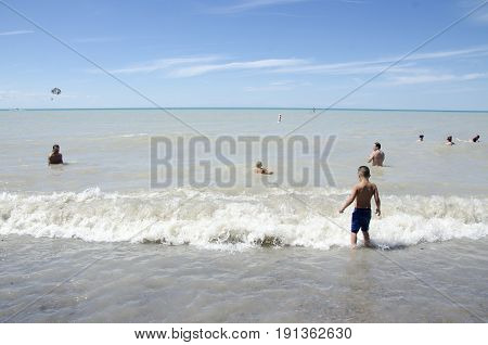 Grand Bend Ontario, Canada - July 02, 2016: Unidentified People Playing In The Lake In The Beach Of