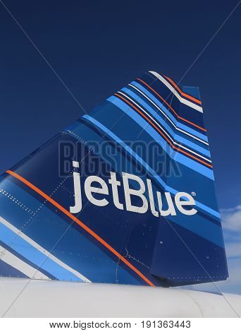 TRUE BLUE, GRENADA - JUNE 13, 2017: JetBlue Embraer 190 barcode-inspired design tailfin at Maurice Bishop International Airport in Grenada