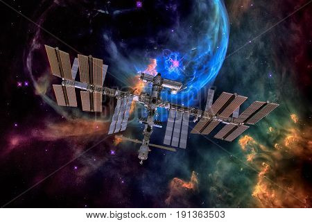 International Space Station Over Nebula.