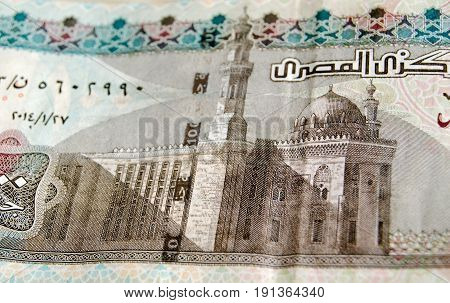 Detail of the Sultan Hassan Mosque in Cairo as depicted on the 100 Egyptian Pound banknote. Used banknote photographed at an angle.