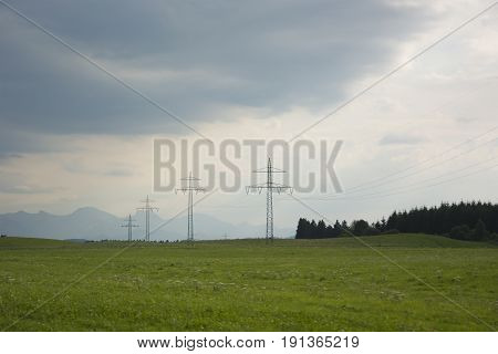 Transmission Towers in a Field in Bavaria, Germany on a Cloudy Day