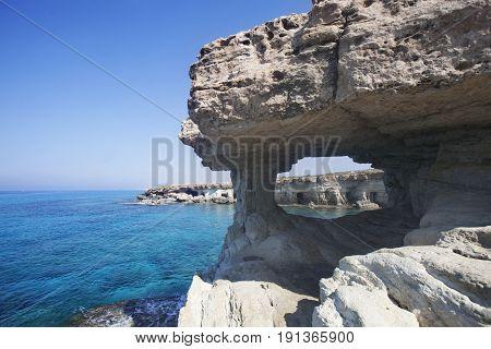 Sea Caves Of Cavo Greco Cape. Cyprus. Mediterranean Sea Landscape