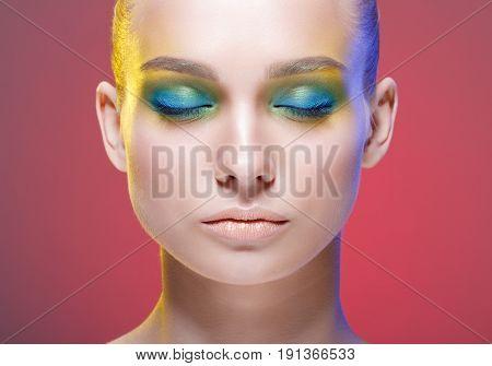 Beautiful woman with bright makeup. Cosmetology , beauty