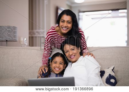Portrait of multi-generation family smiling together at home