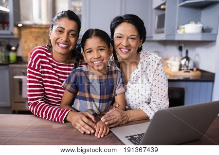 Portrait of smiling multi-generation family in kitchen at home