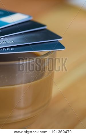 Credit Card And Glass Of Hot Coffee On Wooden Table, Soft Tone. Shallow Focus