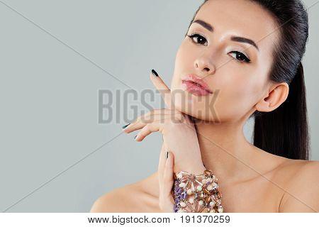 Beautiful Woman with Jewelry Bracelet Fashion Portrait