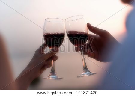 Close-up Of Couple Hands Holding Champagne Flutes During Celebration At Sunset Beach.