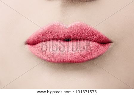 Female Beauty. Love Lips Macro. Kissing Lips with Pink Color Makeup