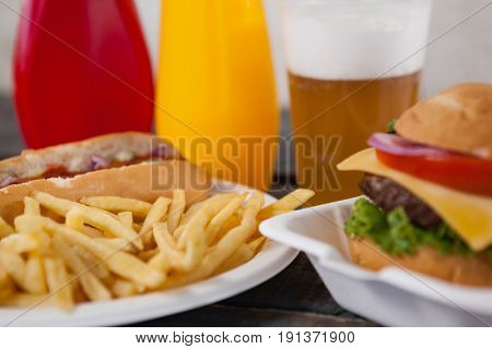 Close-up of hamburger and french fries on table