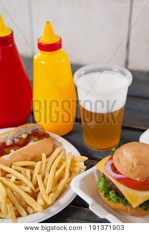 Close-up of drink and snacks on wooden table