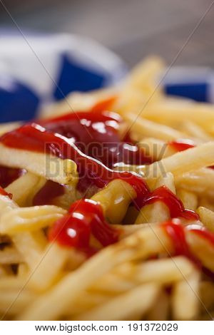 Close-up of ketchup on french fires