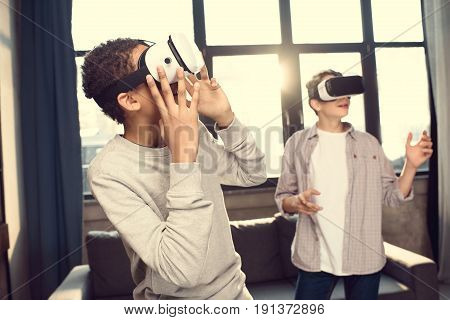 Teenage Boys Wearing Virtual Reality Headsets At Home, Teenagers Playing Video Games Concept