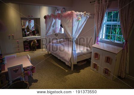 Interior of neat bedroom at home