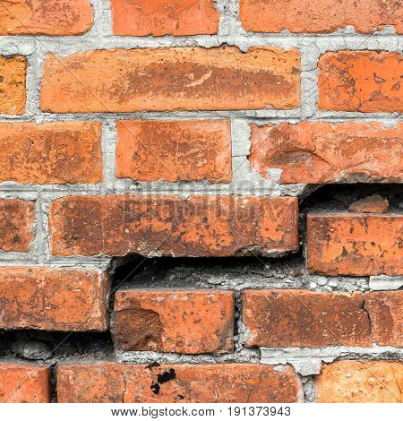 Destroyed brick wall background or texture. Broken wall.