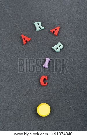 ARABIC word on black board background composed from colorful abc alphabet block wooden letters, copy space for ad text. Learning english concept