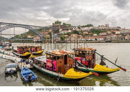 PORTO,PORTUGAL - MAY 13,2017 - Embankment of Douro River in Porto. Porto is one of the oldest European centres and its historical core was proclaimed a World Heritage Site by UNESCO in 1996.