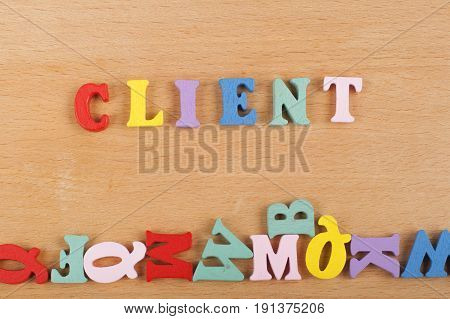 word on wooden background composed from colorful abc alphabet block wooden letters, copy space for ad text. Learning english concept