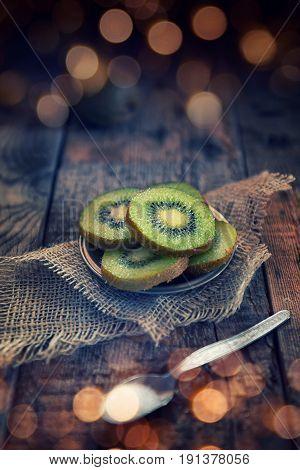 Kiwi fruit half cut on aces wood background
