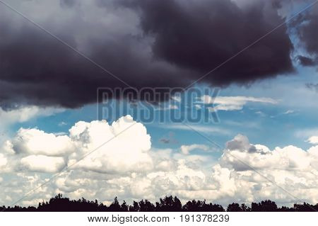 Ominous Sky With Black Cloud And White Clouds